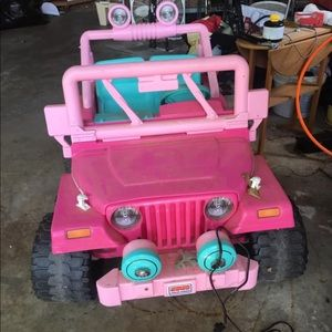 Fitbit iconic and a pink Jeep